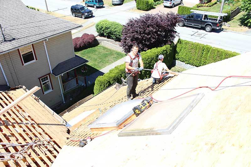 Reroofing house in Vancouver