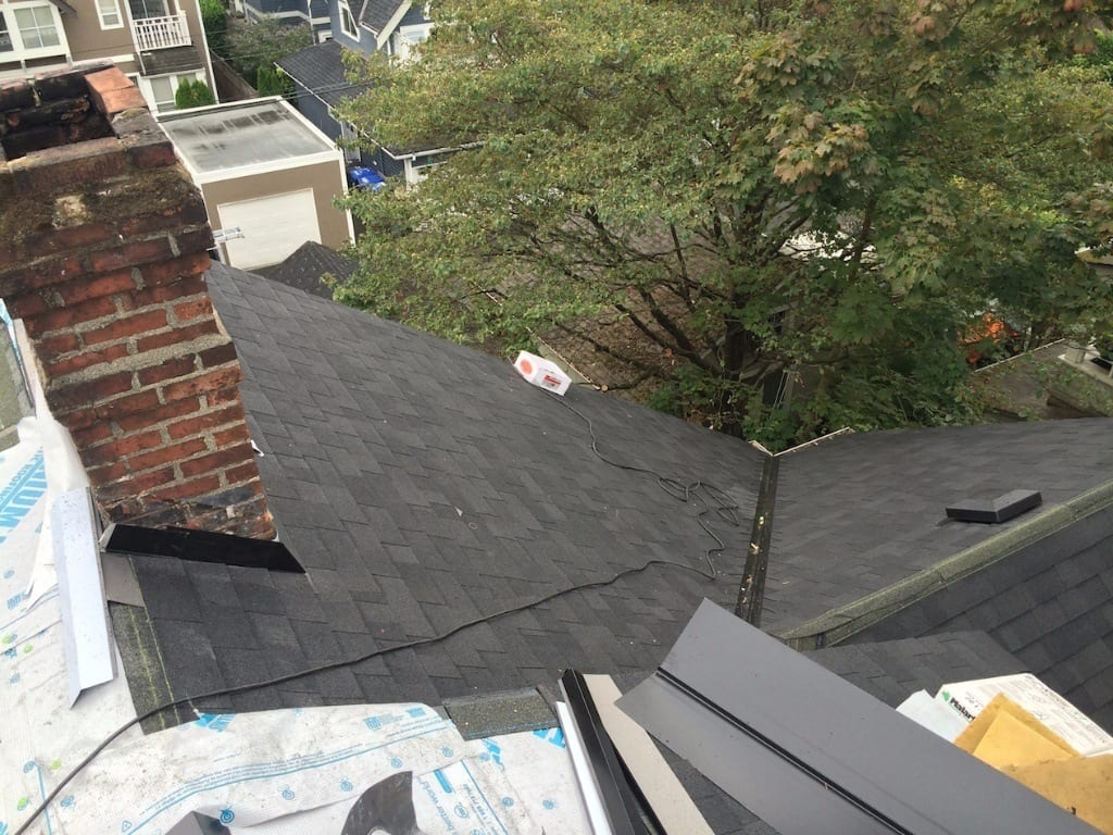almost completed shingles roofing project for house in burnaby bc