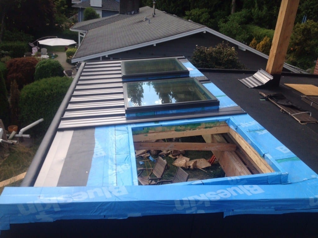 install metal roof with skylight